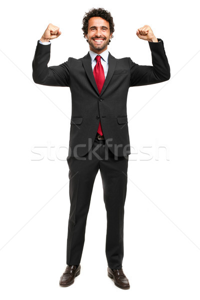 Handsome manager raising arms in sign of victory Stock photo © Minervastock