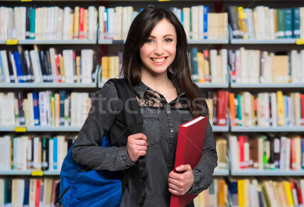 Portrait of a beautiful student in a library Stock photo © Minervastock