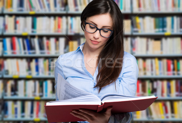 close-up of young girl with glasses reading a book in a bookstore Stock photo © Minervastock