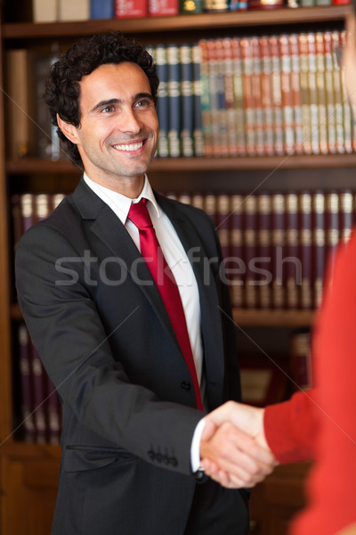 Lawyer shaking hands with a client Stock photo © Minervastock