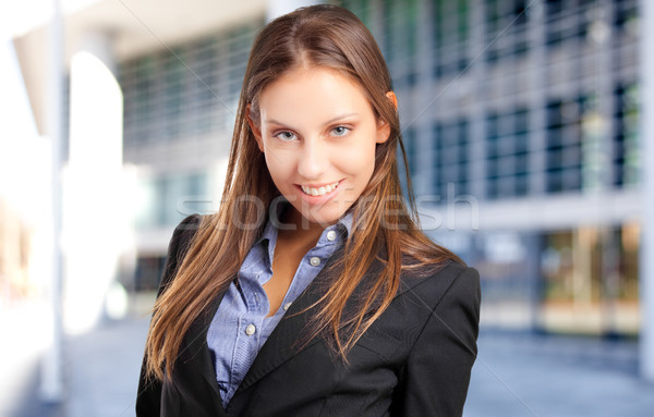 Smiling young female manager Stock photo © Minervastock