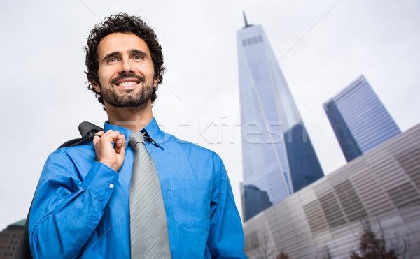 Man zakenwijk glimlach achtergrond zakenman stedelijke Stockfoto © Minervastock