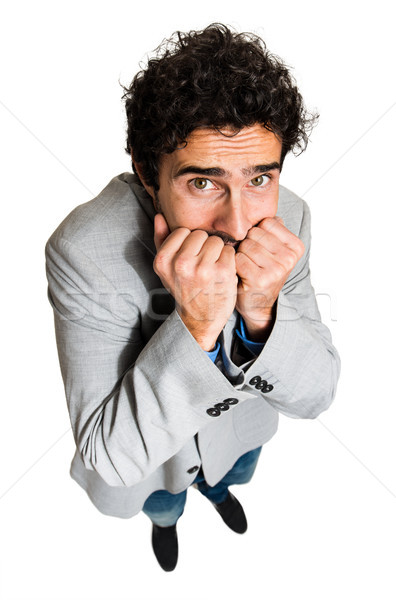 Portrait of a businessman with a funny scared facial expression Stock photo © Minervastock