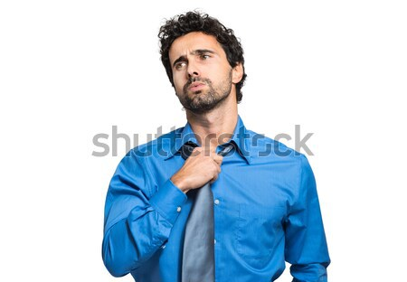 Sweating businessman due to hot climate Stock photo © Minervastock