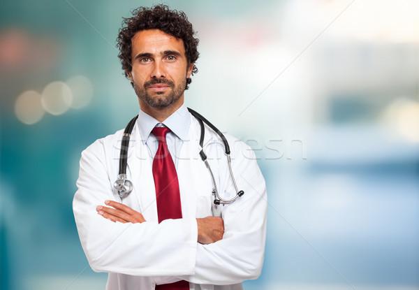 Yakışıklı doktor portre gülümseme mutlu arka plan Stok fotoğraf © Minervastock