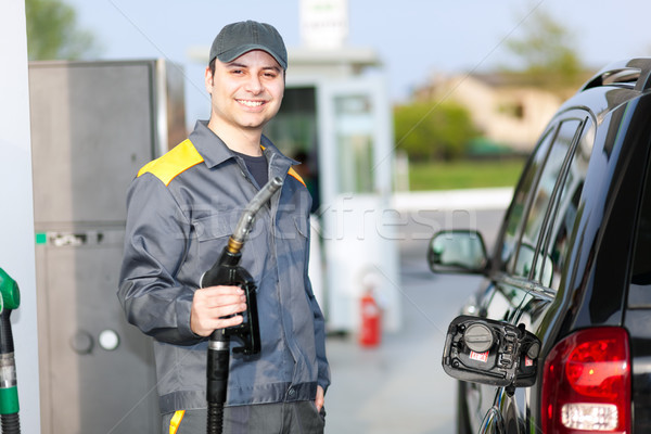 Smiling gas station worker Stock photo © Minervastock