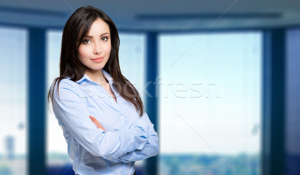 Smiling young female manager portrait Stock photo © Minervastock