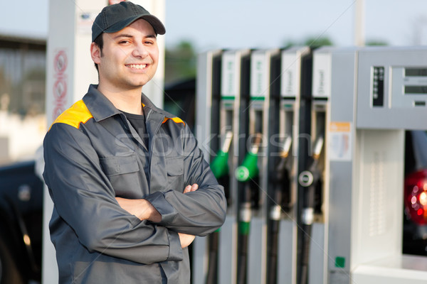 Sonriendo gasolinera trabajador mano Trabajo motor Foto stock © Minervastock