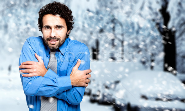 Portrait of a frozen businessman in the cold winter Stock photo © Minervastock