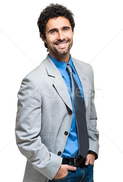 Yakışıklı işadamı yalıtılmış beyaz iş gülümseme Stok fotoğraf © Minervastock