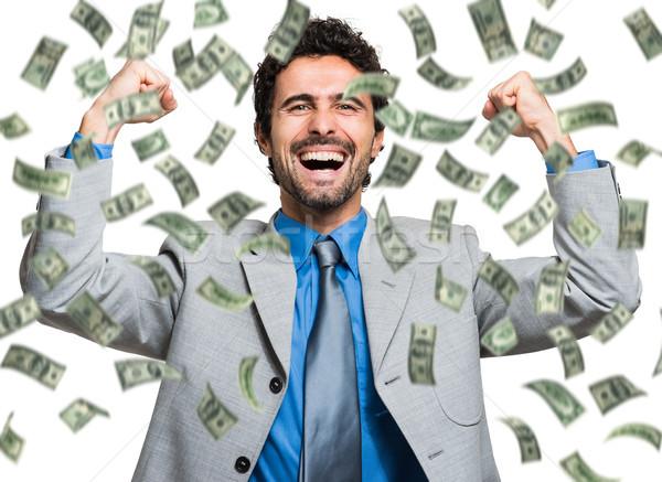 Boldog férfi élvezi eső pénz üzletember Stock fotó © Minervastock