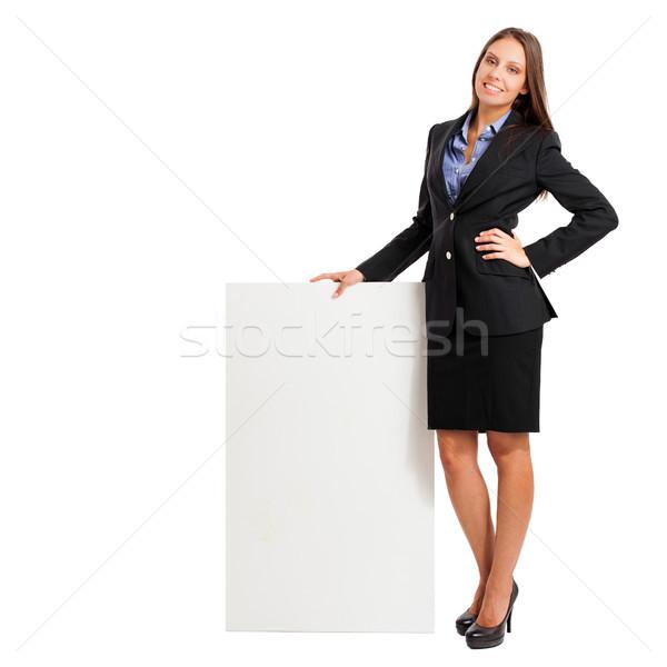 Gyönyörű nő mutat üres tábla nő mosoly diák Stock fotó © Minervastock