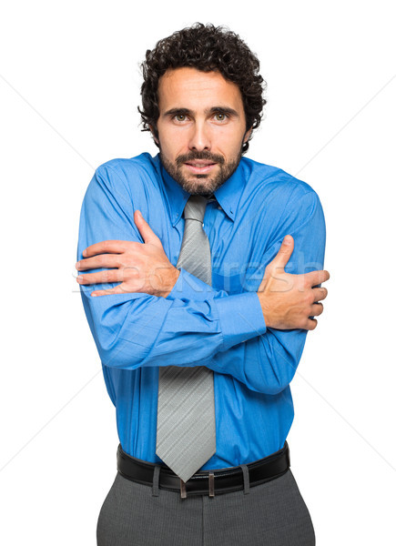 Portrait of a freezing businessman  Stock photo © Minervastock