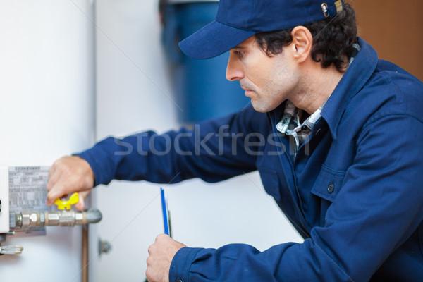 Plumber repairing an hot-water heater Stock photo © Minervastock