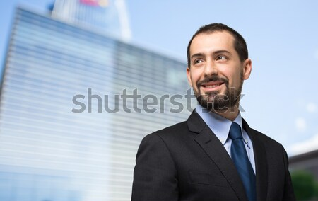 Portrait of a handsome businessman isolated on white Stock photo © Minervastock