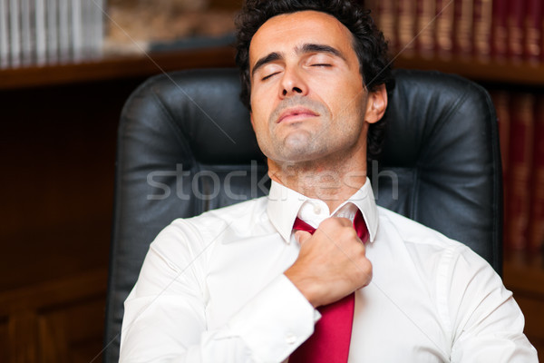 Businessman loosing his necktie after an hard working day Stock photo © Minervastock