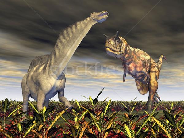 Stock photo: Carnotaurus attacks Amargasaurus