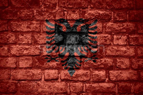 Zászló Albánia szalag tégla textúra Stock fotó © MiroNovak