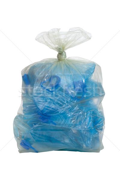 plastic bag with crushed blue plastic bottles cutout on white Stock photo © MiroNovak