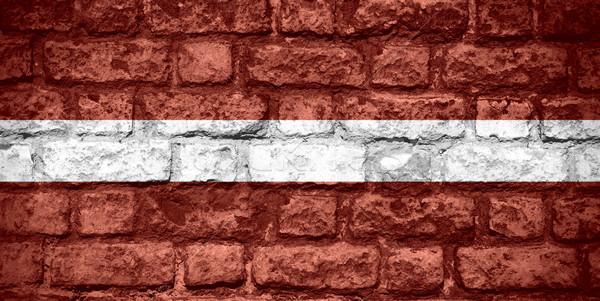 Zászló Lettország szalag tégla textúra Stock fotó © MiroNovak