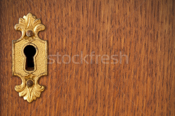 keyhole on wooden background Stock photo © MiroNovak