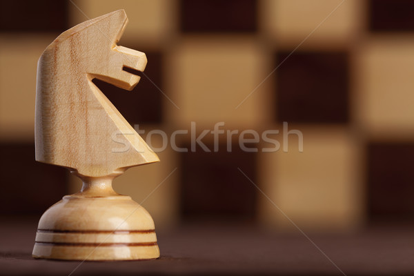 white knight on chessboard background Stock photo © MiroNovak