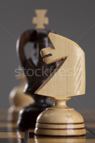 Beyaz şövalye siyah kral satranç tahtası arka plan Stok fotoğraf © MiroNovak