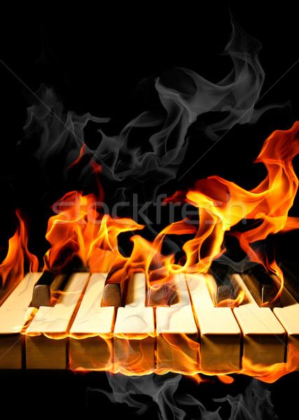Piano flammes brûlant feu clavier fond Photo stock © Misha