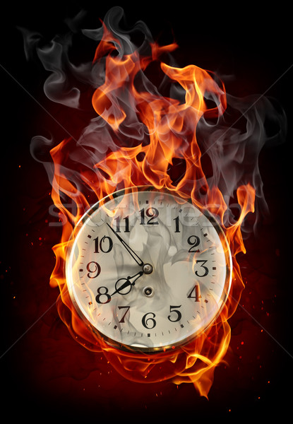 Stock photo: Burning clock