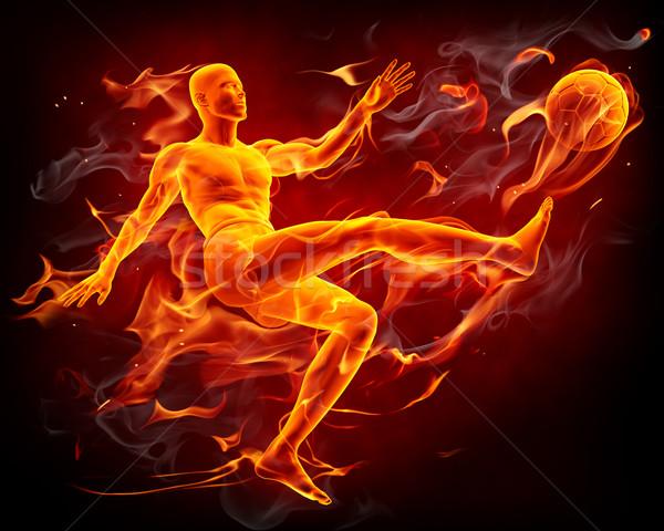 Fogo jogador de futebol ardente bola homem Foto stock © Misha