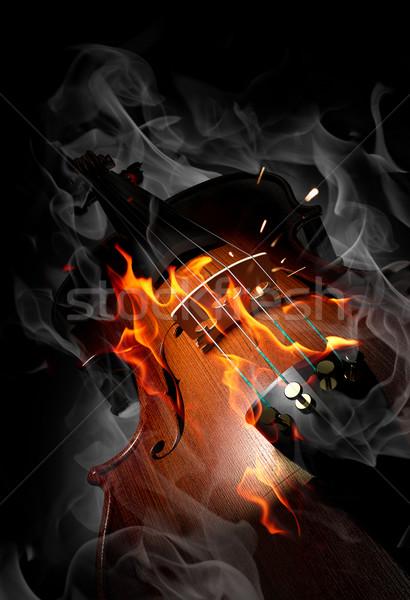 Violin in fire Stock photo © Misha