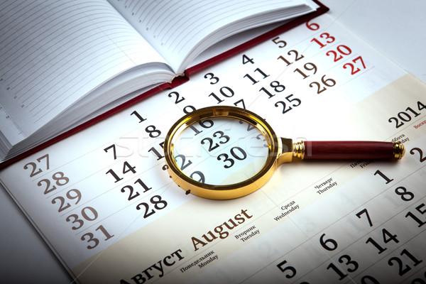 magnifier on the diary Stock photo © mizar_21984