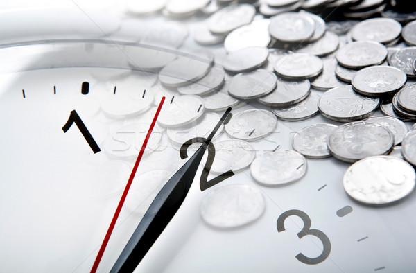 clock face and Russian ruble coins and digits closeup Stock photo © mizar_21984