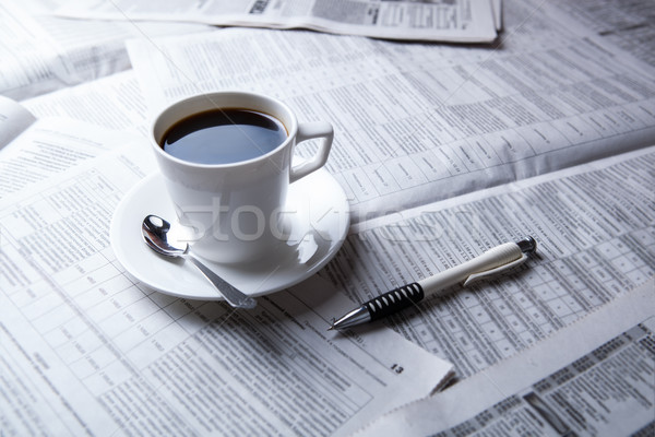 Stock photo: cup of coffee and the newspaper