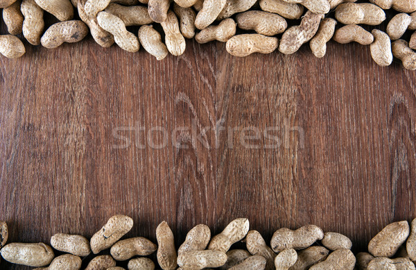 peanuts on the wooden background Stock photo © mizar_21984