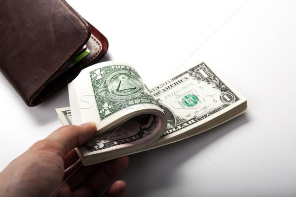 hand holds a dollar bill Stock photo © mizar_21984