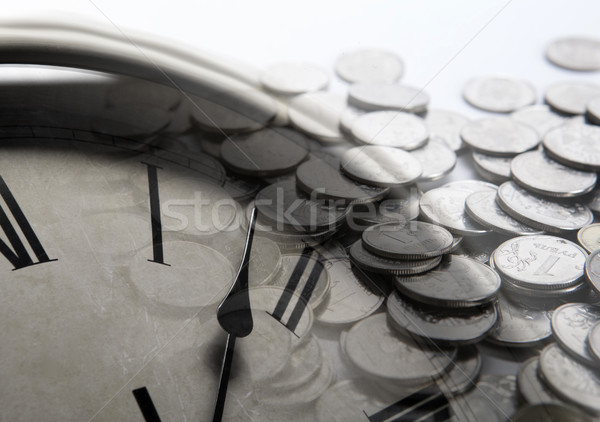 pile of coins with clock face Stock photo © mizar_21984