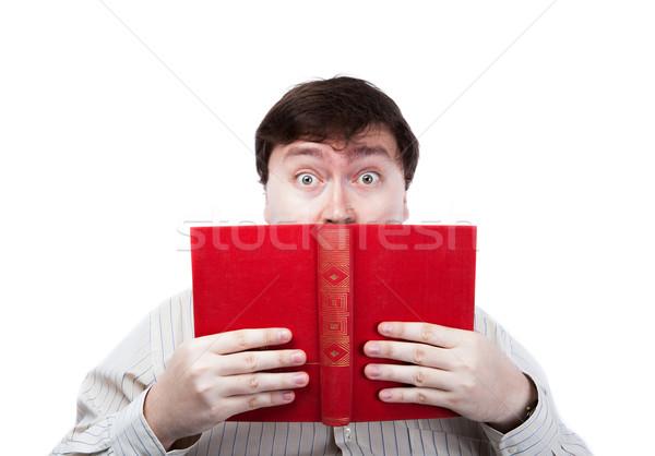 man in stress holding an open red book Stock photo © mizar_21984