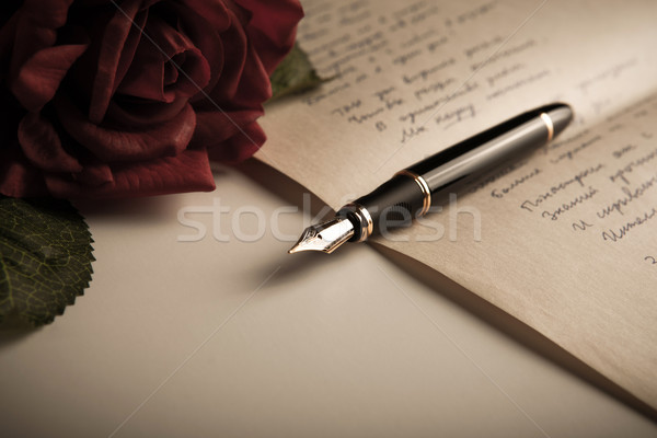 fountain pen on text sheet paper with rose Stock photo © mizar_21984