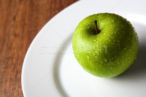 fresh green apple on a white plate Stock photo © mizar_21984
