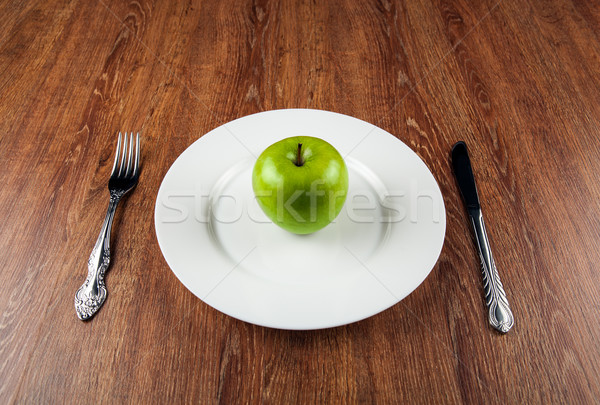 table appointments and the fresh green apple on a white plate Stock photo © mizar_21984