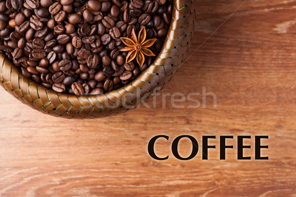 roasted coffee beans in a bamboo basket with title Stock photo © mizar_21984
