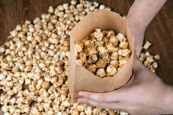man holding a bag of popcorn Stock photo © mizar_21984