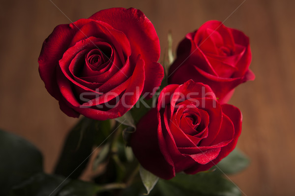 bouquet of roses on a wooden background Stock photo © mizar_21984