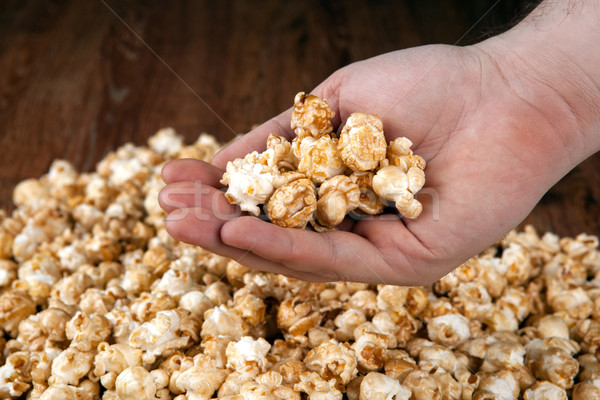 man holds a handful of popcorn in his hands Stock photo © mizar_21984