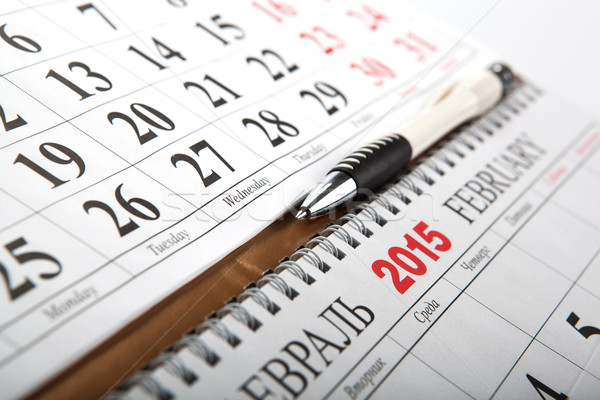wall calendars with pen laid on the table Stock photo © mizar_21984