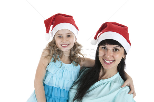 mother with a little daughter in Christmas caps Stock photo © mizar_21984