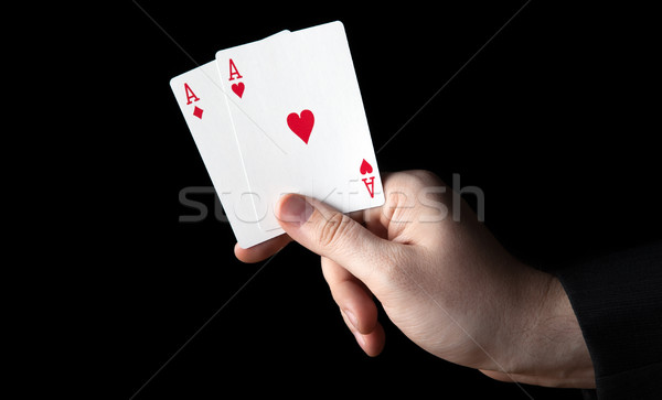 human hand holding two aces Stock photo © mizar_21984