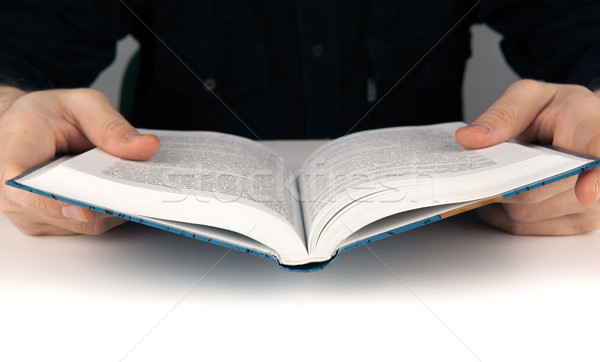 Man's hands and man looking for something in the book Stock photo © mizar_21984