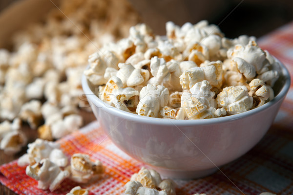 popcorn into a bowl on a napkin in the kitchen Stock photo © mizar_21984